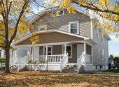 Older duplex house in Midwest in fall. poster