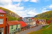 Houses on the street of historic town in Harpers Ferry National Historical Park West Virginia USA. poster