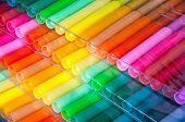 Panels of colour felt-tip pens laid by a fan poster