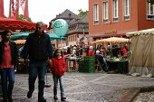 MAINZ, GERMANY - SEPTEMBER 04: The stalls of the weekly market in the town square in Mainz with various fruits and vegetables from regional suppliers on September 04 2015 in Mainz. poster