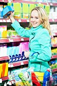 smiling woman shopping toiletries and household cleaning supplies goods. poster