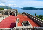 The fortress Kanli Kula (Bloody Tower) on the background of sea and mountains Herceg Novi Montenegro poster