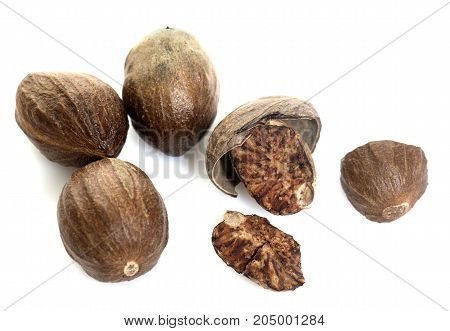 open nutmeg in front of white background