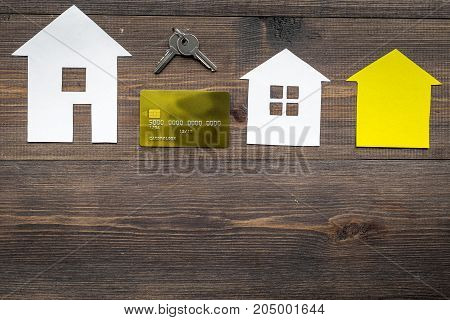 work desk with paper house figures for selling house set wooden background top view space for text
