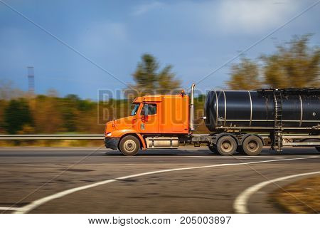 Blurred truck photo in motion, cargo transportation of gasoline or oil concept