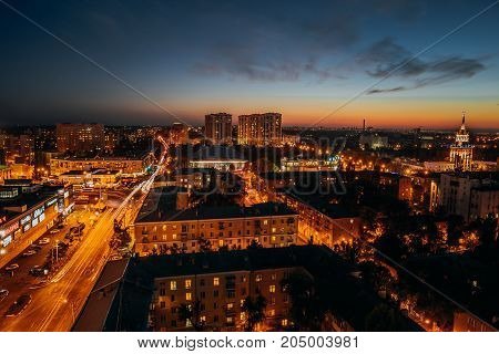 Voronezh, Russia, Circa September 2017: panorama of the night city center of Voronezh with streets, traffic, shopping centers or malls and apartment buildings, view from the height