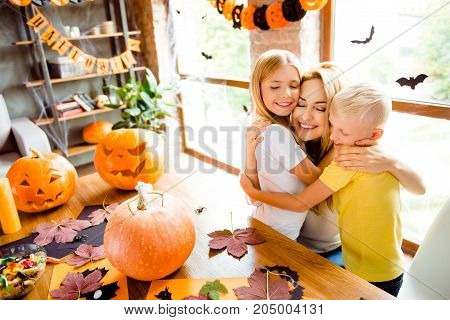 Lovely Family Cuddling, Mum With Two Small Blonde Cheerful Kids In Decorated Nice Loft Light Room At