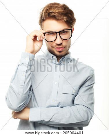 Casual man posing casually over white background