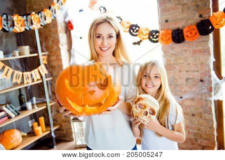 Adorable Small Blonde Girl And Her Mommy Are Showing Decorations For A Halloween Party, Pretty Mum I