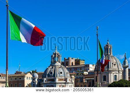 flags in the wind on Monumento Nazionale a Vittorio Emanuele II or Altare della Patria (Altar of the Fatherland) Rome Italy.