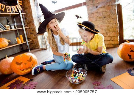 Sweets For Us! Treat Or Trick! Very Cheerful Excited Small Kids In Carnival Head Wear, With Colorful