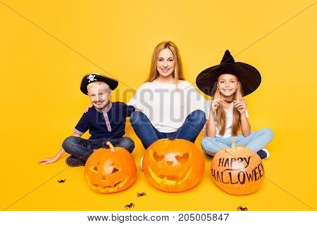 Ready For The Spooky Party! Blonde Mother With Two Small Cheerful Kids, Girl Is A Wizard, Boy Is A P