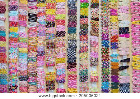 Many hairpins or hairclips as a background. Selective focus image.