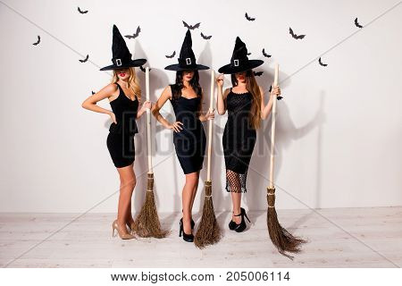 Full Length Of Group Of Three Mysterious Hidden Mistress Vampire Monsters In Elegant Costume Clothin