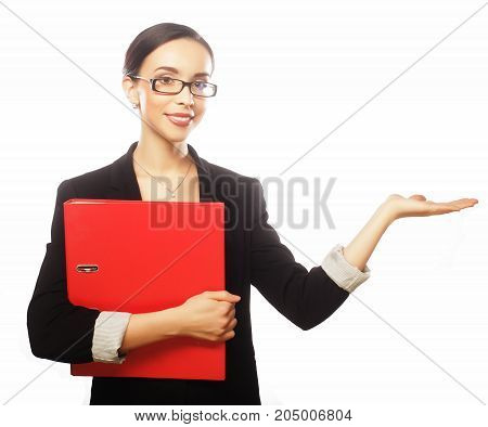young business woman holding folders and showing empty copy space on open hand palm for text, white background