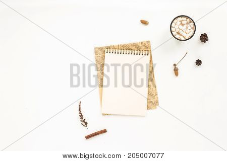 Autumn Workplace. Notebook, Pine Cone, Dried Branches, Cup Of Coffee, Marshmallow On White Backgroun