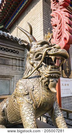 Tianjin, China - Nov 1, 2016: A bronze Qilin (Kirin) along the famous Tianjin Ancient Cultural Street. Qilin is a mythical animal in Chinese folklore.