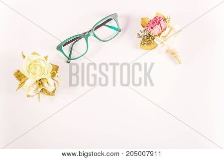 Bouquet of flowers and glasses.White background.Flat lay top view.Copy space for text.stylish minimalistic templateplate