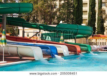 Swimming Pool Slides For Child On Blue Water Slide At Aquapark