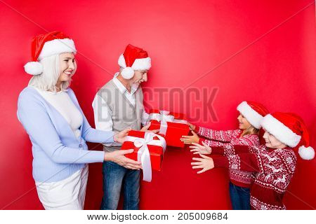 Four Relatives: Excited Siblings Taking Surprises Boxes With Ribbon From Married Elder Couple Of Gra