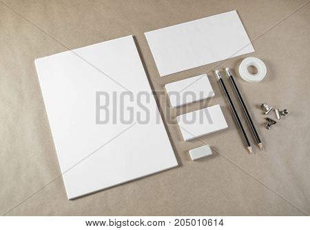 Photo of blank stationery set on craft paper background. Corporate identity template. Responsive design mockup.