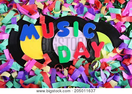 Vinyl Records With Inscription Music Day On Colorful Confetti