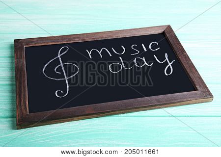 Inscription Music Day on the black blackboard