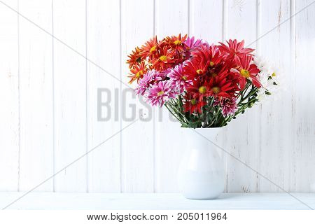Bouquet Of Chrysanthemum Flowers On A Wooden Table