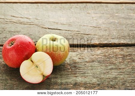 Ripe And Sweet Apples On Wooden Table