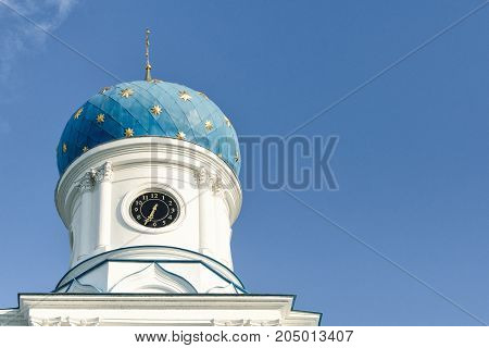 Blue dome of an orthodox temple against a blue sky. Bottom view