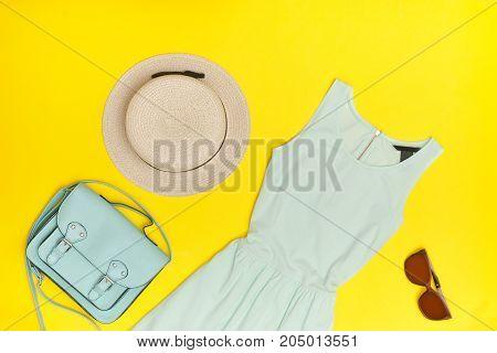 Fashionable Concept. Female Summer Wardrobe. Mint Dress, Hat, Hahdbag, Glasses. Yellow Background