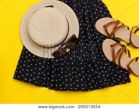 Fashionable Concept. Female Summer Wardrobe. Straw Hat, Sundress, Sunglasses, Sandals. Yellow Backgr