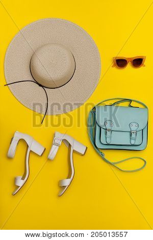 Fashionable Concept. Women's Beach Hat, Handbag, White Shoes. Yellow Background, Top View