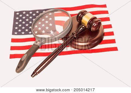 Large Magnifying Glass and Judges Gavel on The American Flag