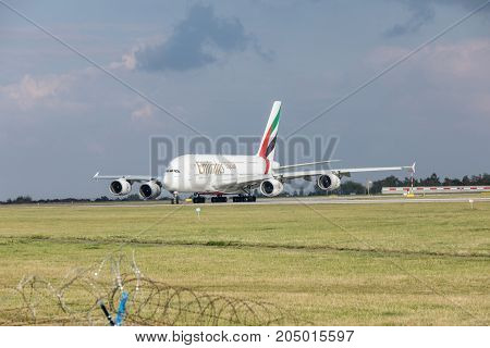 PRAGUE CZECH REPUBLIC - SEPTEMBER 20 2017: EMIRATES AIRLINES Airbus A380-800 rolls on the runway before departure from Prague. Emirates is an airline of the United Arab Emirates based in Dubai.