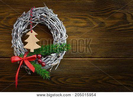 Christmas wreath decoration on a dark wooden background