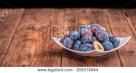 Wooden Table With Plums, Selective Focus