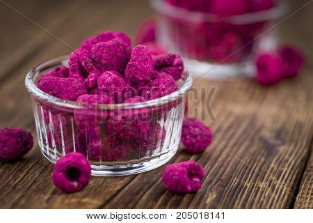 Wooden Table With Dried Raspberries, Selective Focus