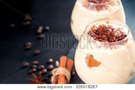 tiramisu in a glass decorated with coffee beans