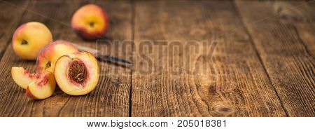 Fresh Peaches On Wooden Background; Selective Focus
