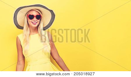 Happy young woman wearing a summer hat