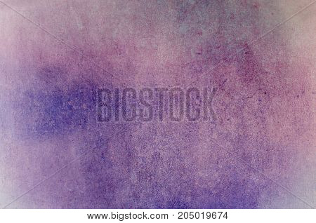 Background combining a rough patchy grunge texture with raindrops in merging pinks and purples