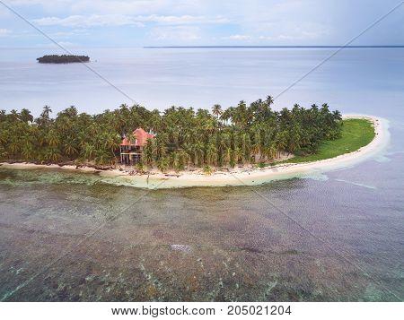 Villa on private island in caribbean sea aerial drone view