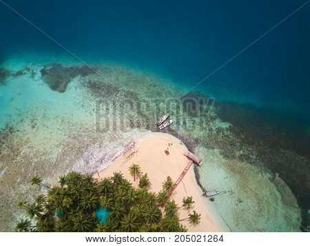 Beach on coral island aerial above view