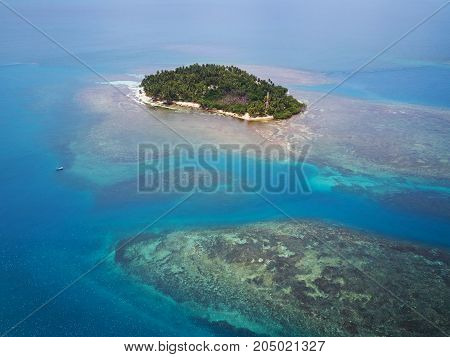 Vacation in tropical island theme. Aerial view on caribbean island