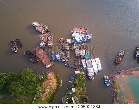 Rusty boats aerial drone view in river