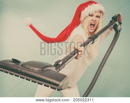 Angry Girl In Santa Helper Hat With Vacuum Cleaner