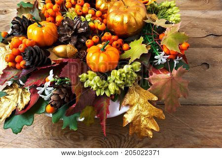 Thanksgiving Greeting With Golden Pumpkin, Autumn Leaves, Berries And Cones