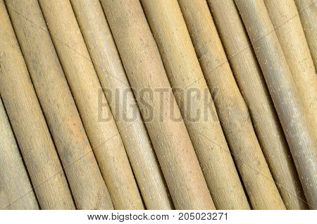 Background from obliquely laid maple thin sticks.