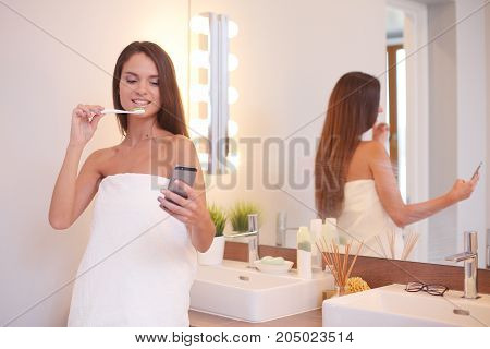 Portrait of a young girl cleaning her teeth.